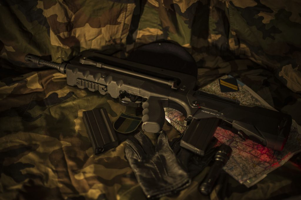 gun on camouflage cloth