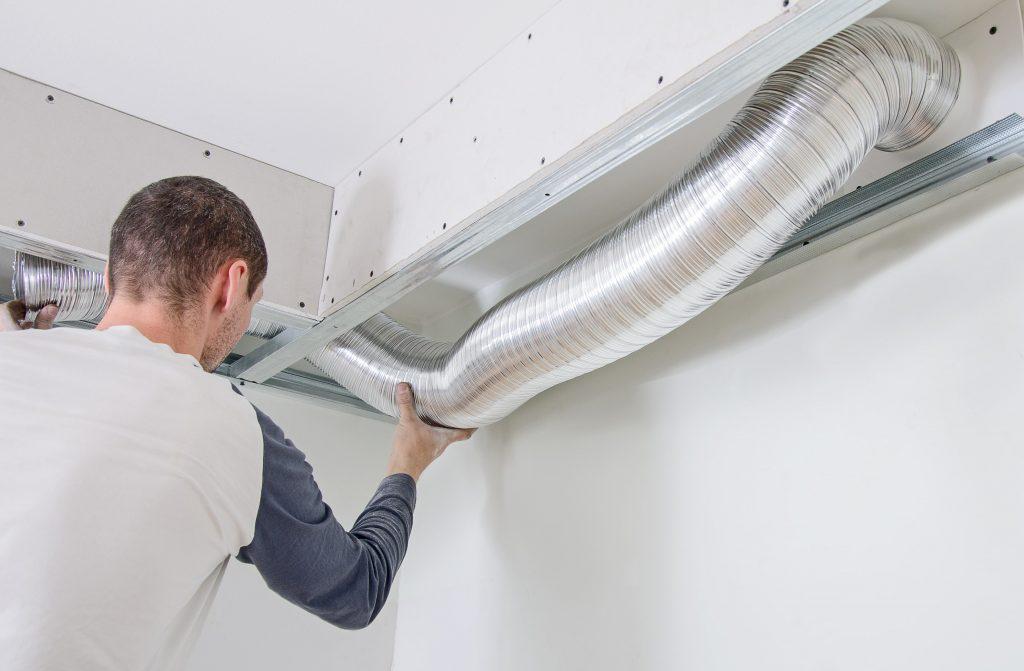 man checking HVAC system