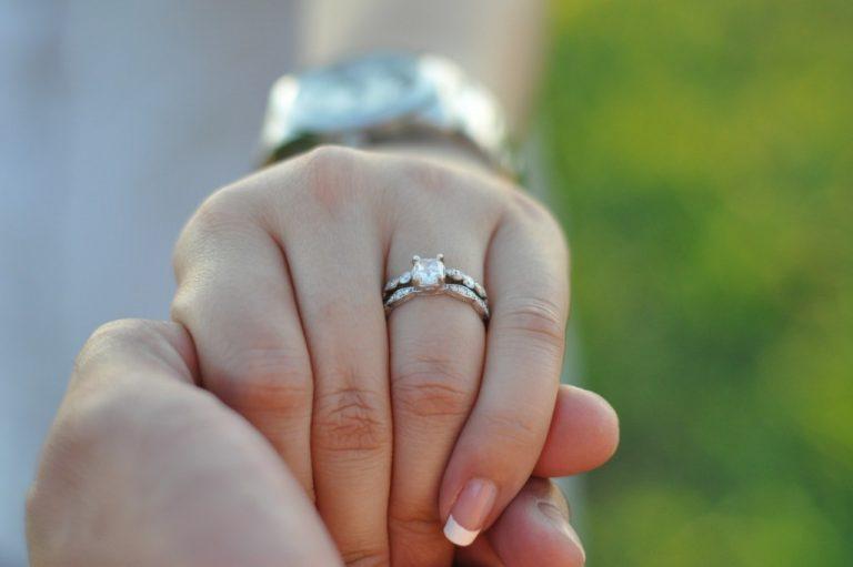 wearing an engagement ring