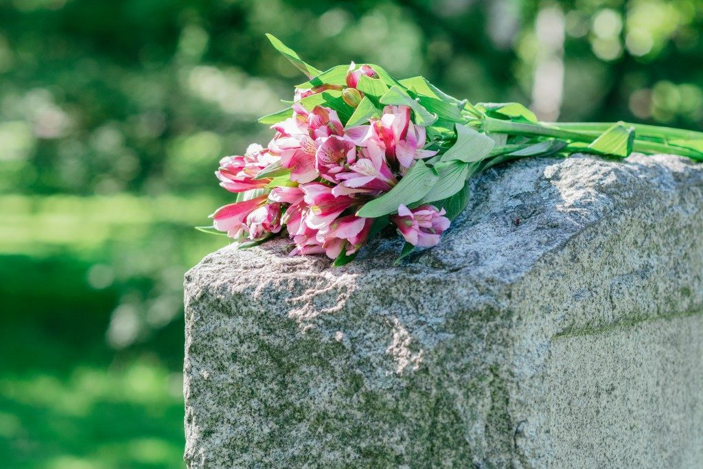 flowers left on top of tombstone