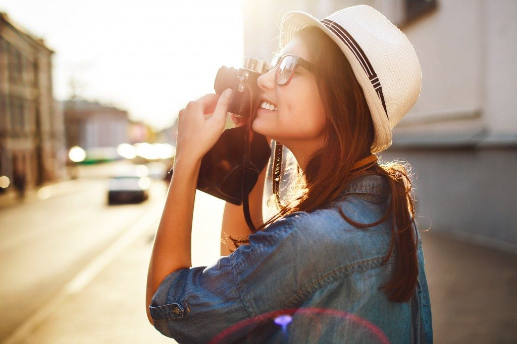 woman taking photos during her vacation