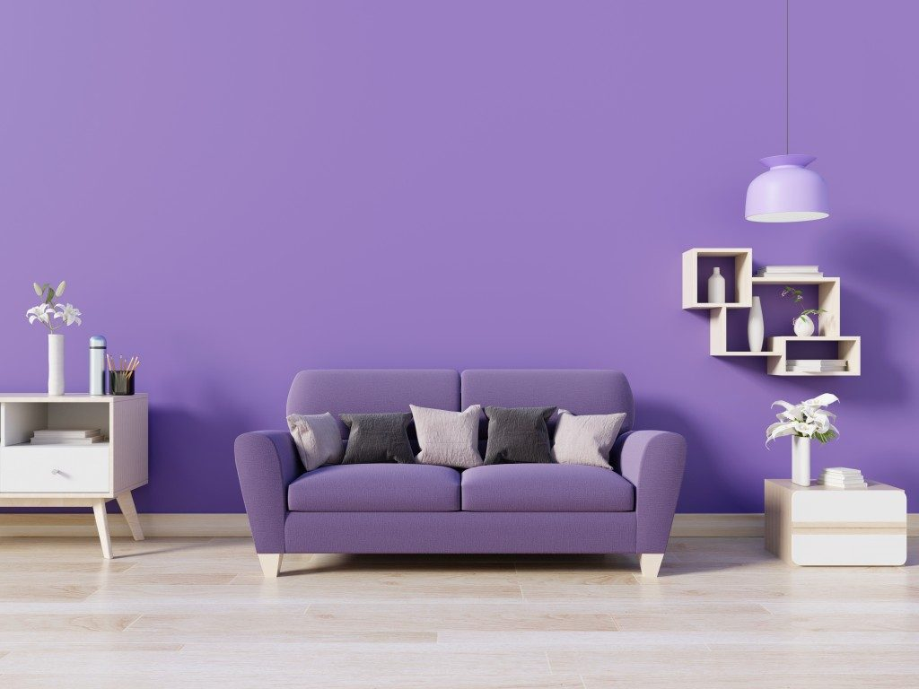 Purple couch near purple wall