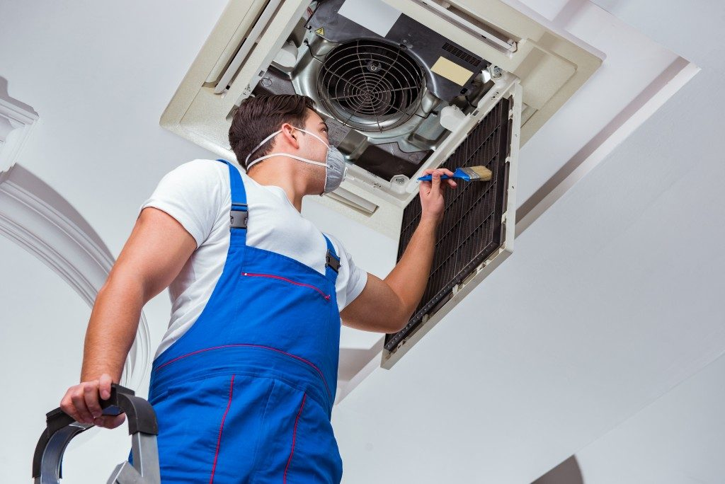 man checking a centralized air conditioner