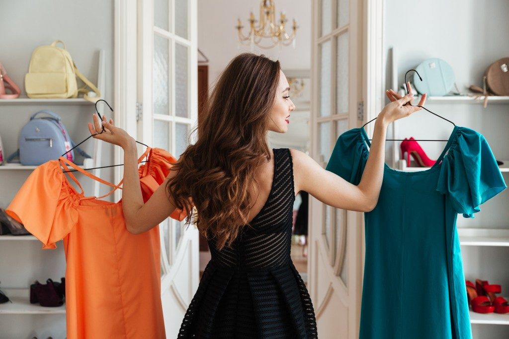 girl choosing dresses