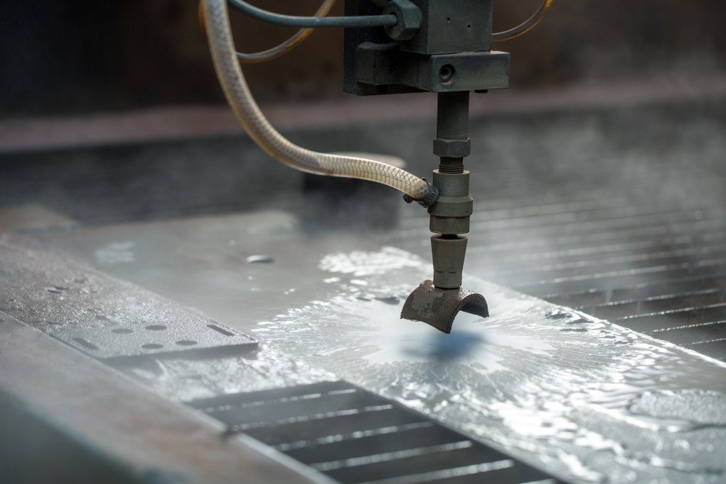 waterjet cutting machine fabricating the metal