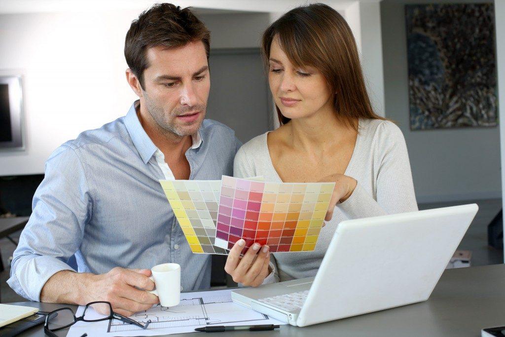 Couple choosing a paint color