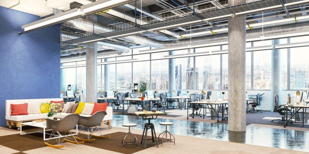 open office space with exposed ceiling