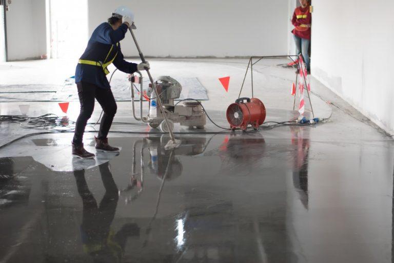 Applying epoxy flooring