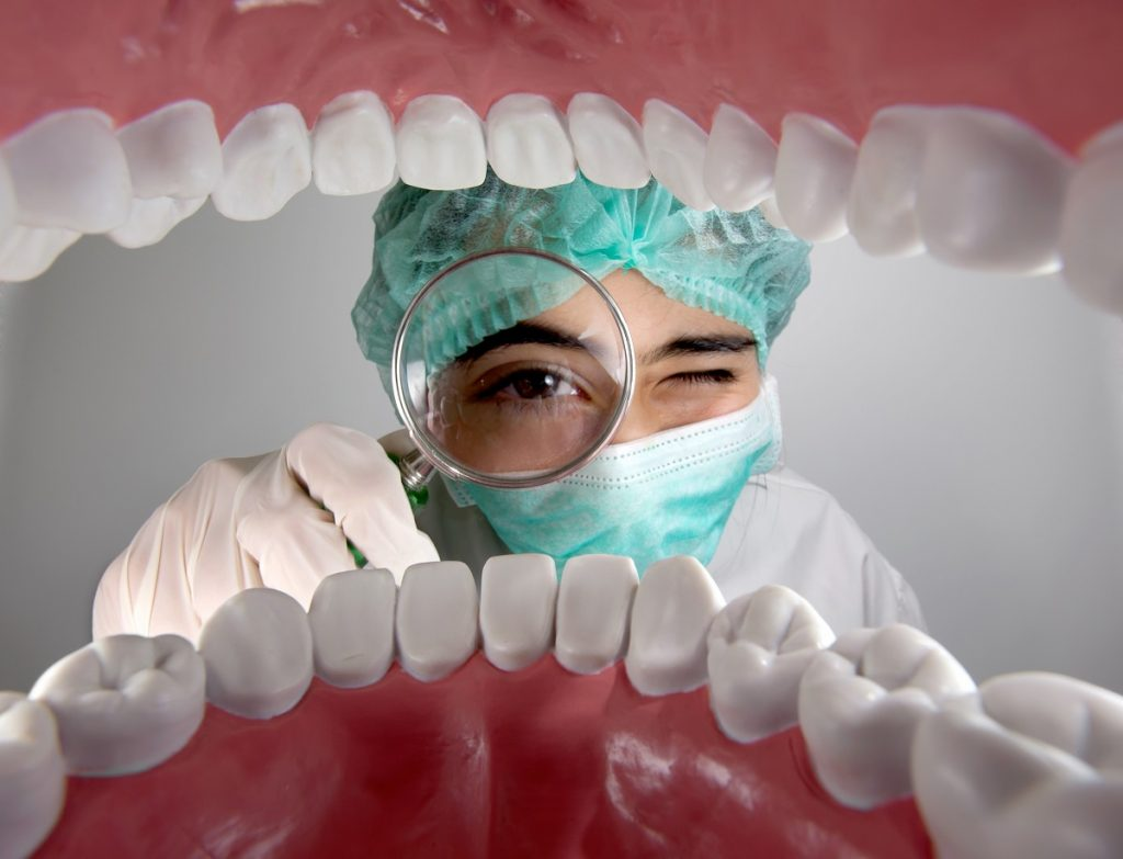 dentist checking the mouth