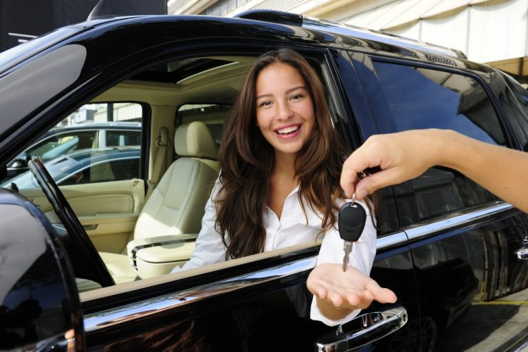 beautiful woman getting a new car
