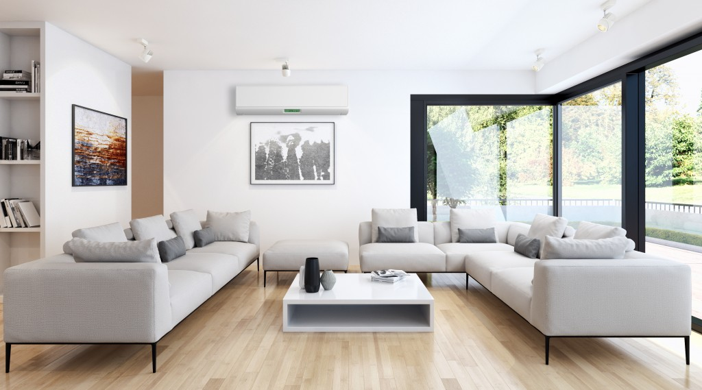 big living room with sofa set and large windows