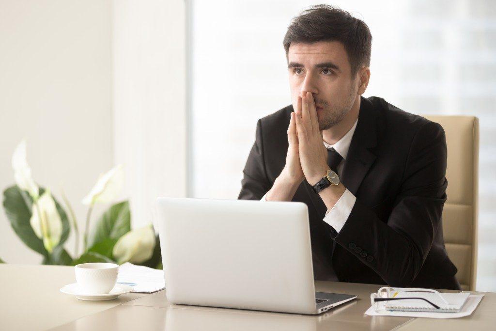 man unhappy at work