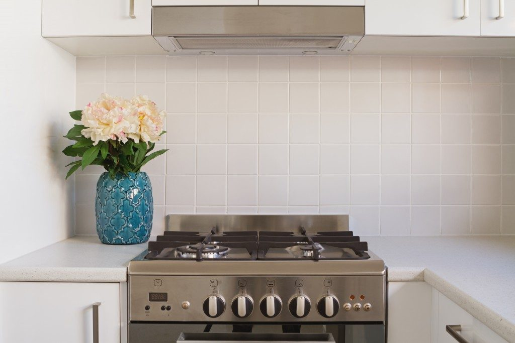 Close up of kitchen oven and tiled splashback in contempory apartmen