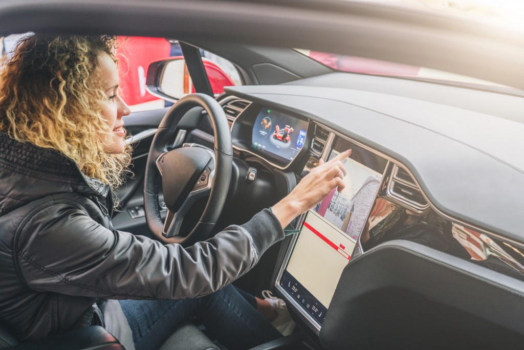 driving a car with touchscreen dashboard
