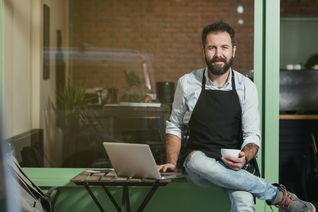 Male business owner with laptop