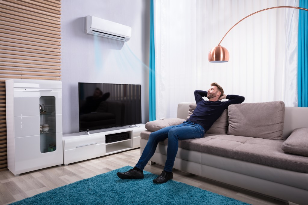man relaxing in the living room