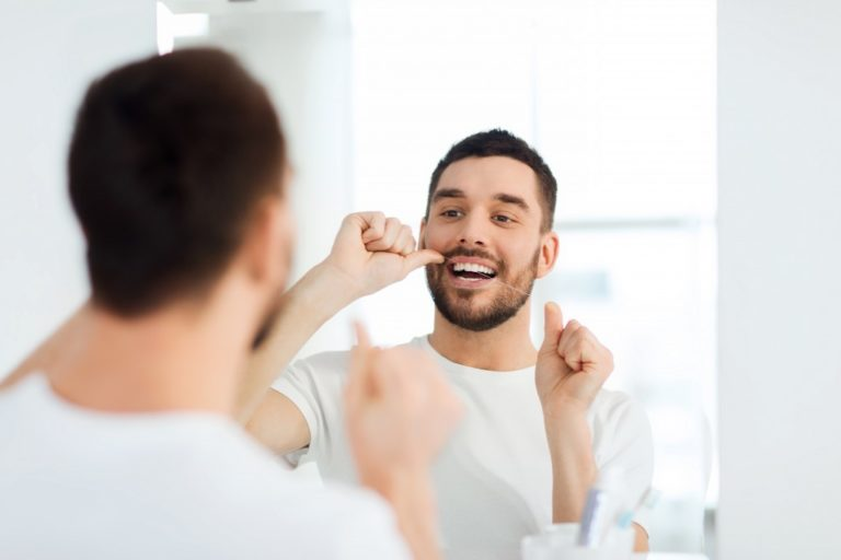 flossing infront of a mirror