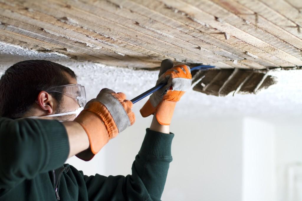 man repairing the ceiling