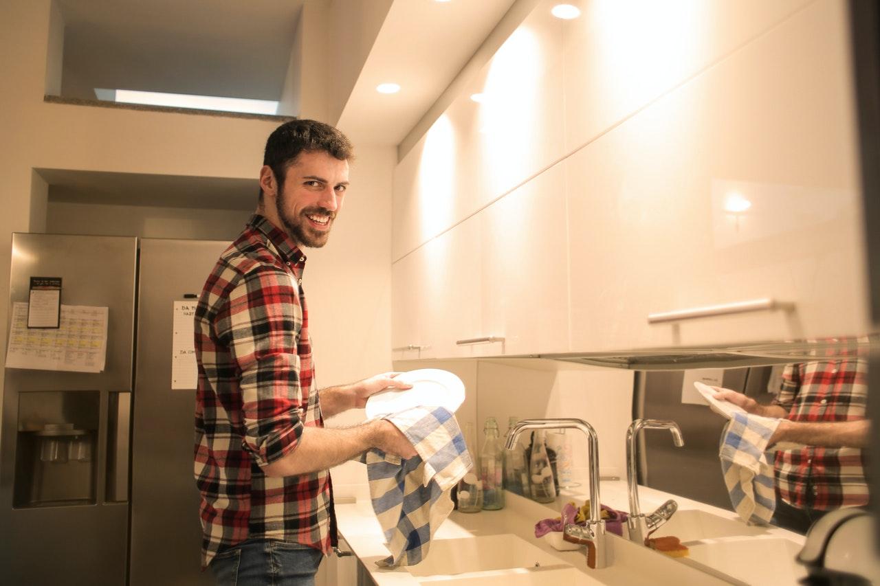 man dishwashing