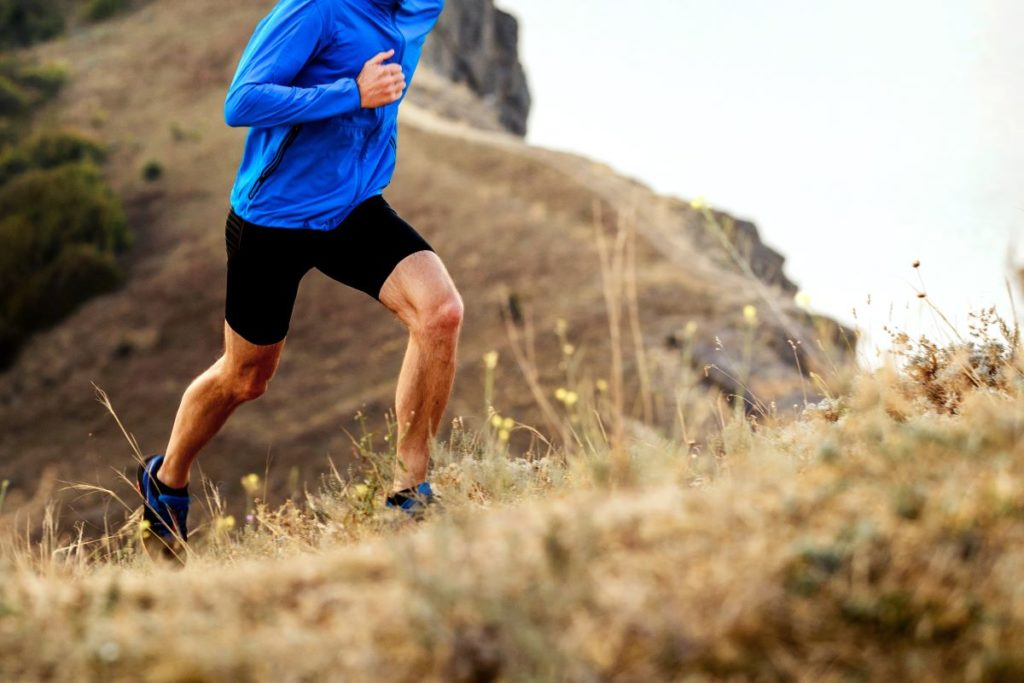 man jogging in the hills