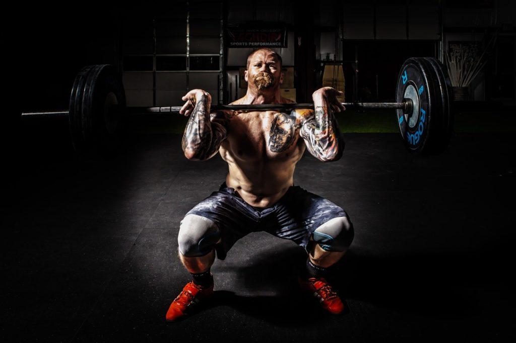 man lifting a barbell