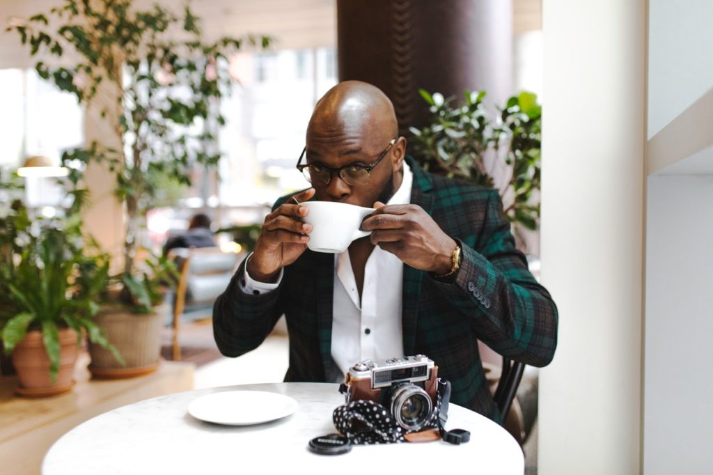 man sipping a coffee