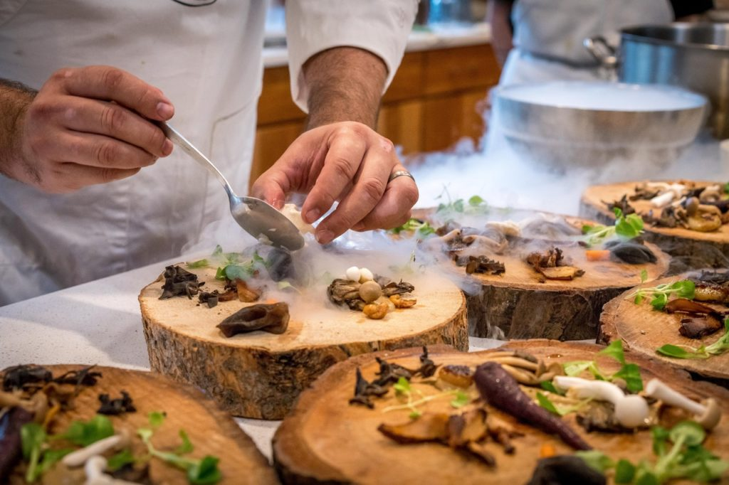 chef plating food with dry ice