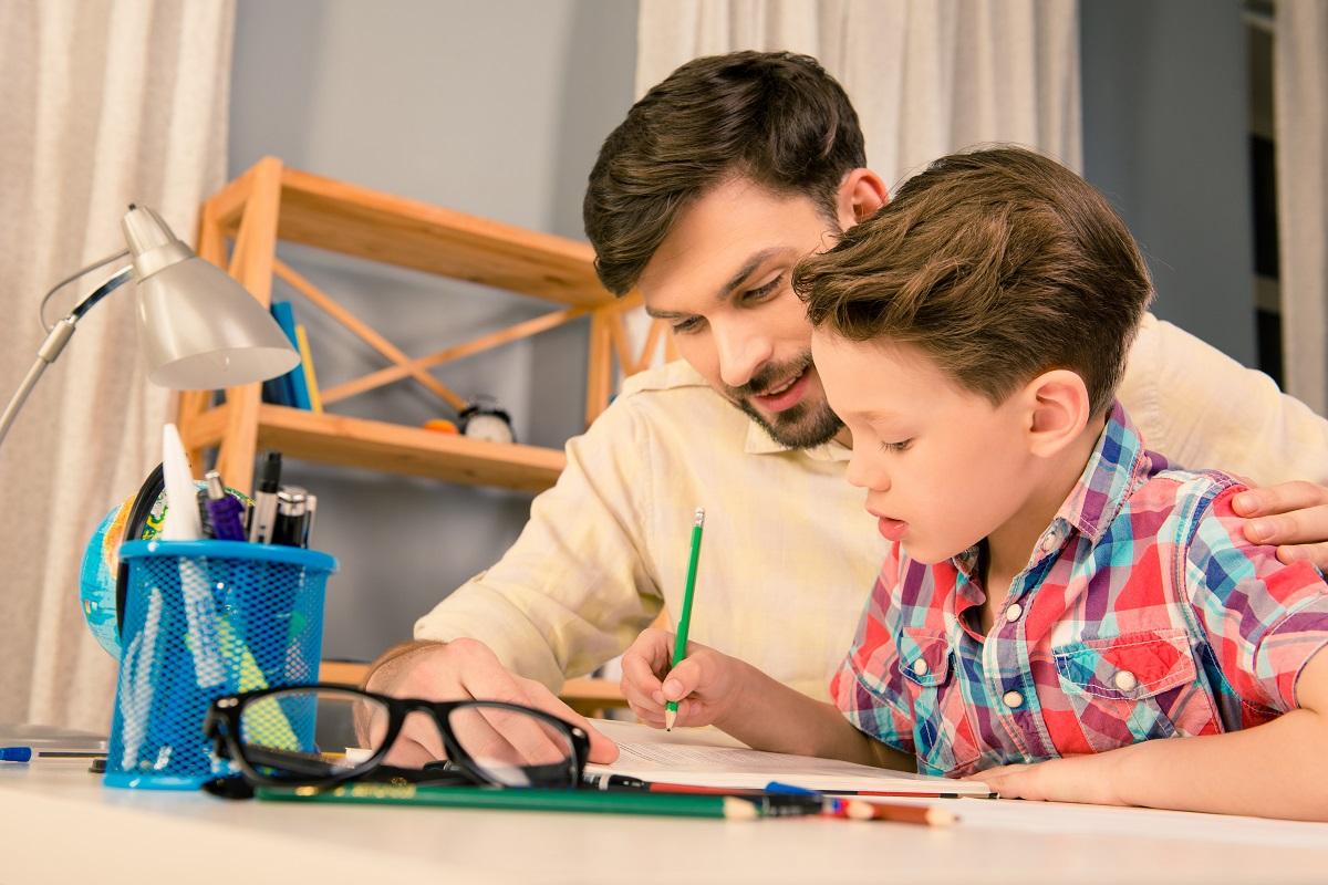 dad teaching his son