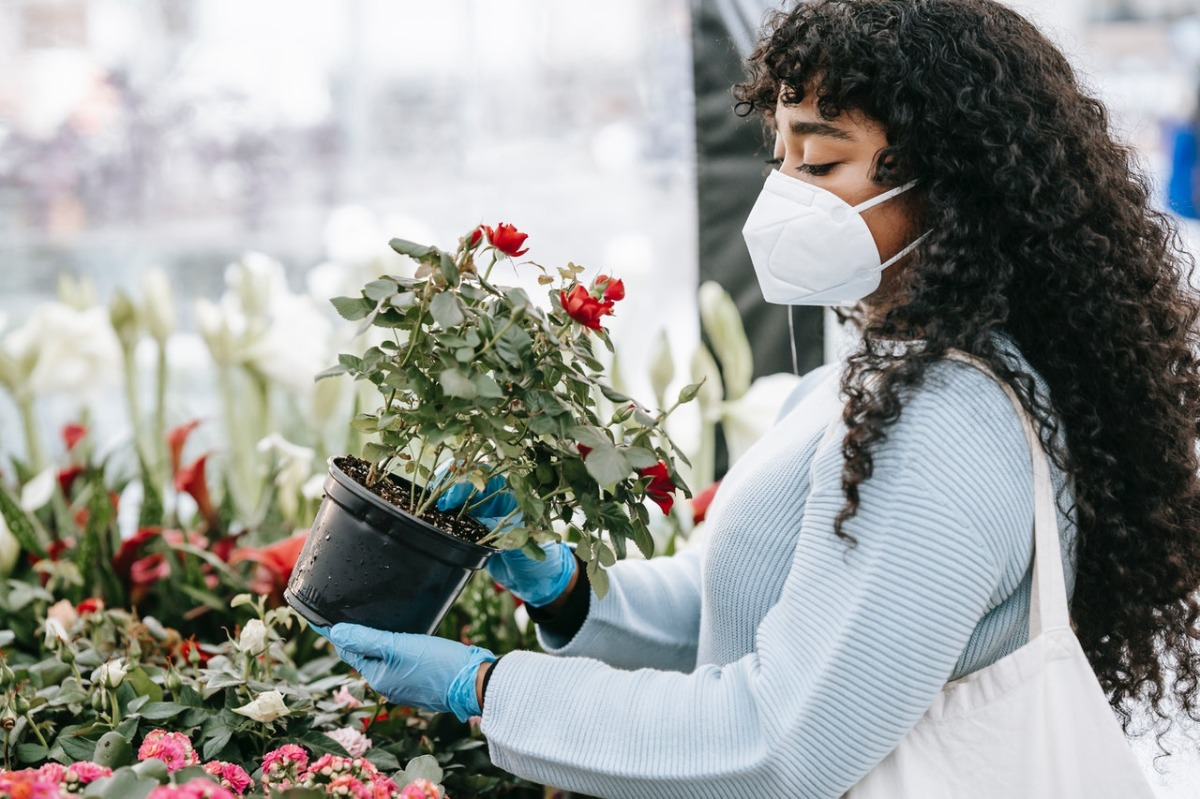 woman buying plants