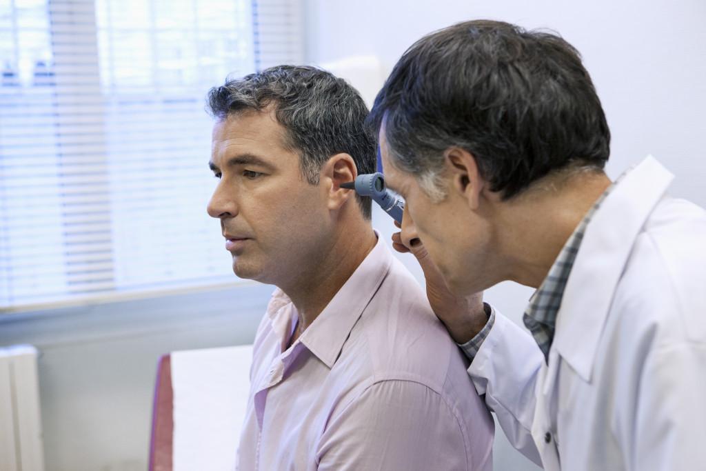 Man getting ear exam
