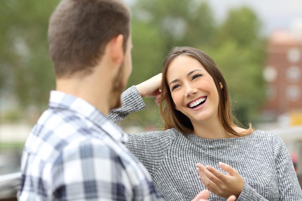 woman talking to man