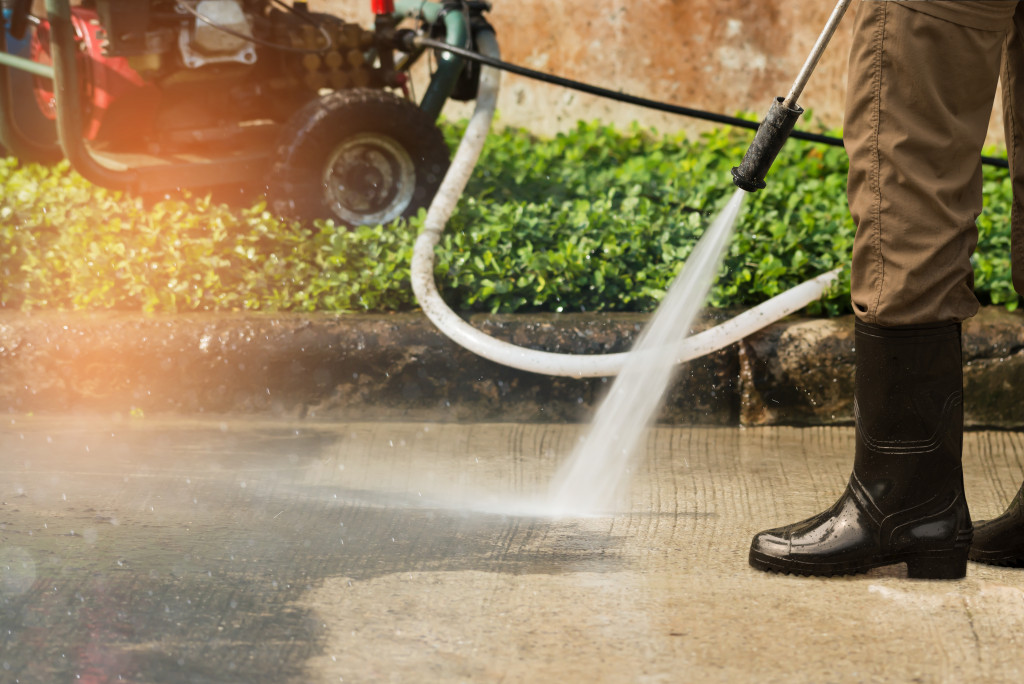 man pressure cleaning