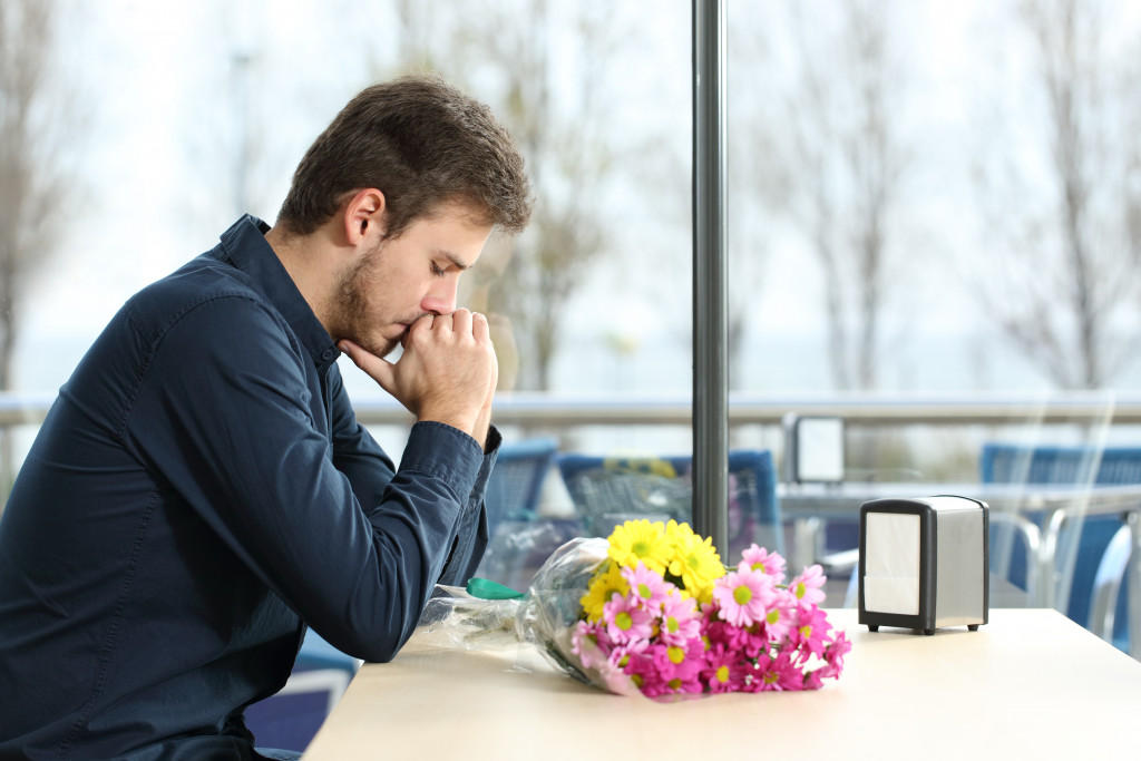 man looking sad after being stood up