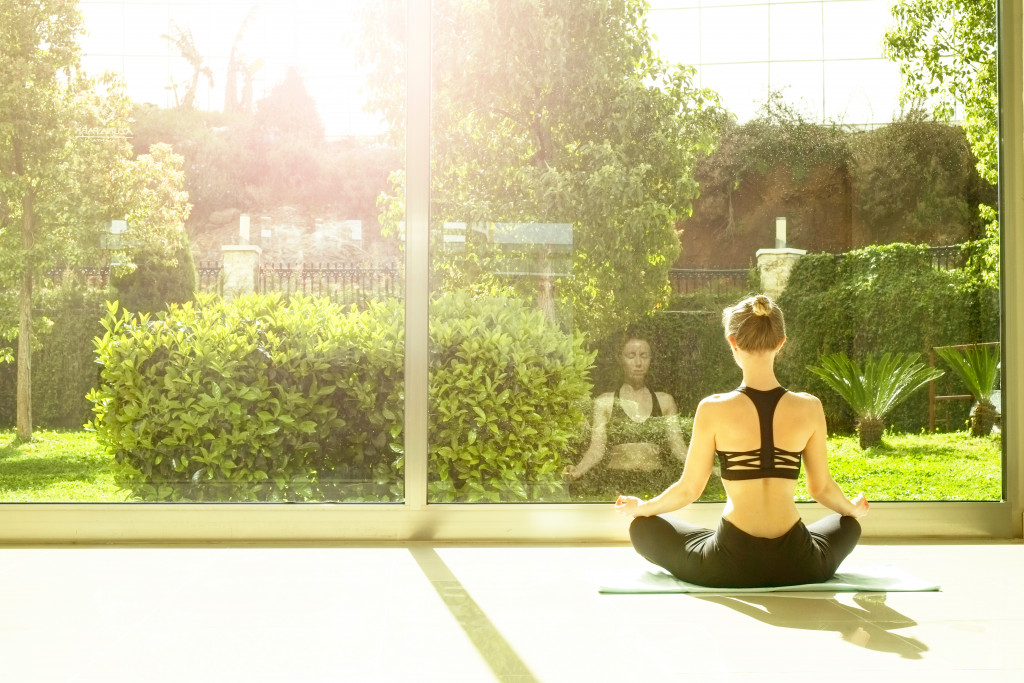 woman meditating and working out